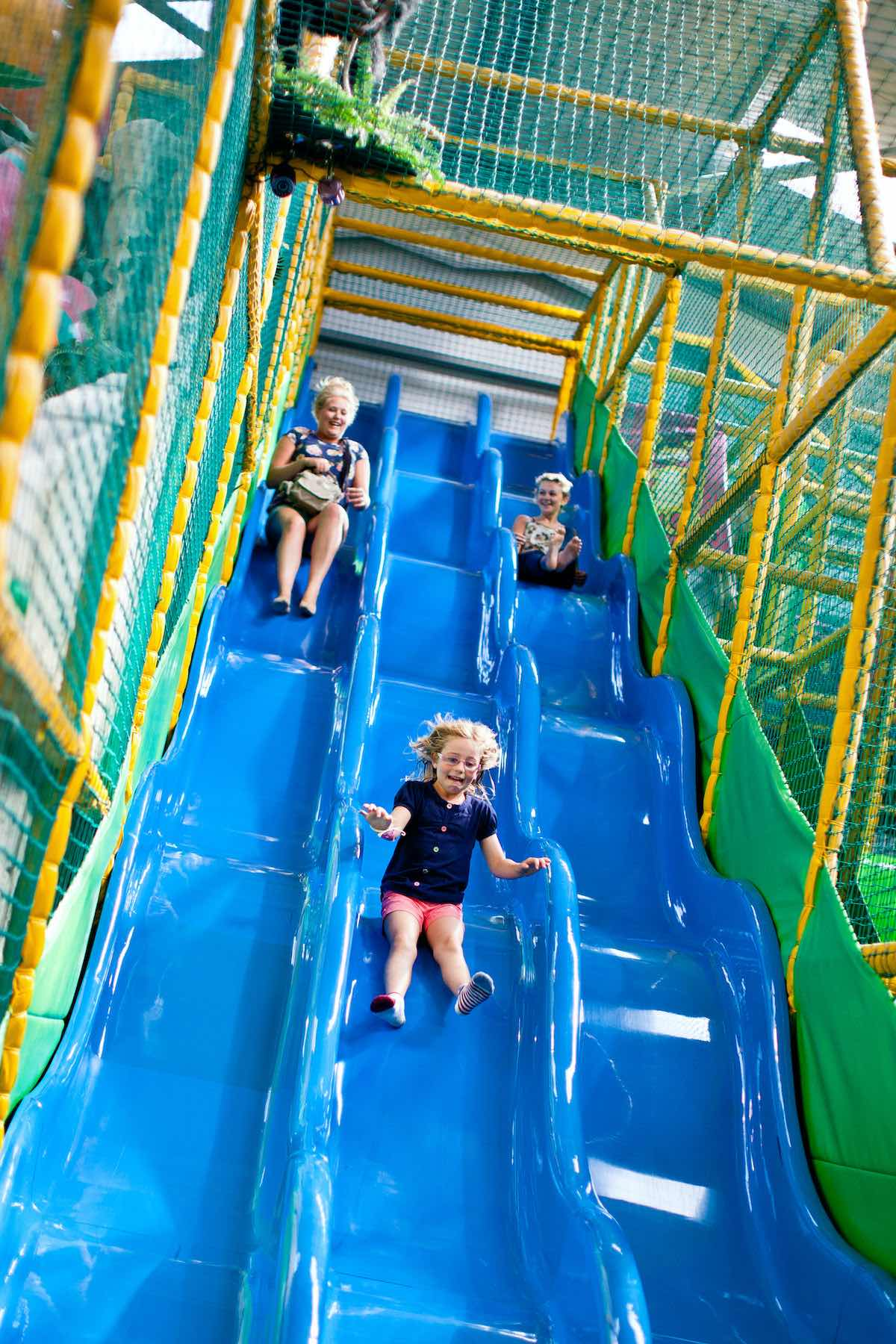Kids on the massive slide at Sundown Adventureland
